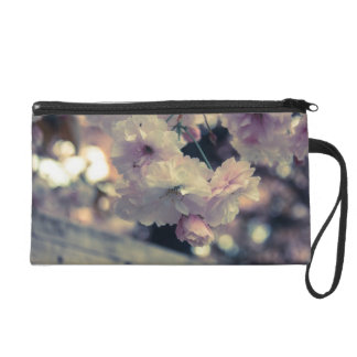 pink and white flower bag wristlets