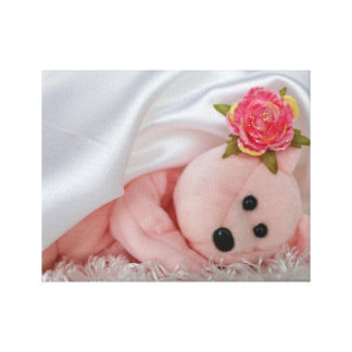 PINK BEAR NDER A WHITE SATIN BLANKET STRETCHED CANVAS PRINT