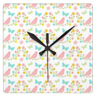 Pink birds and blue butterflies clocks
