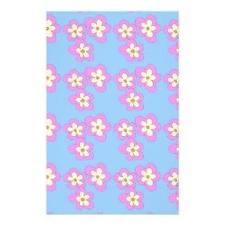 Pink blossom on blue stationery