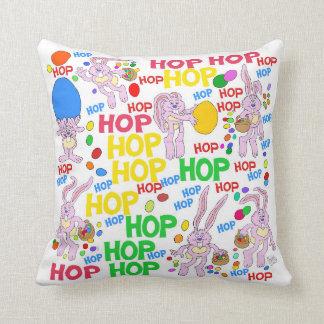Pink bunnies, on a square cushion. cushion