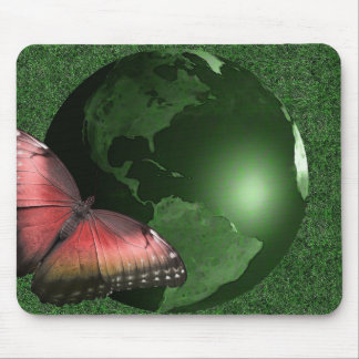 Pink butterfly on a green world mouse pad