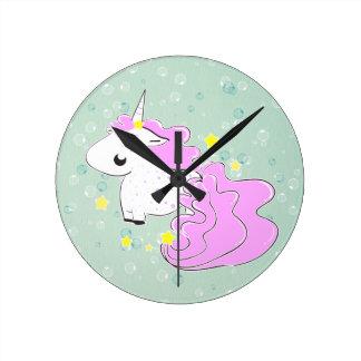 Pink cartoon unicorn with stars clock