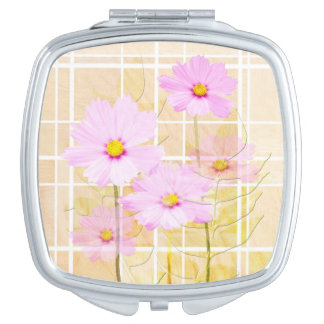 Pink cosmos cosmo flower cream yellow background makeup mirror
