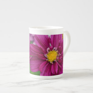 Pink cosmos flowers tea cup