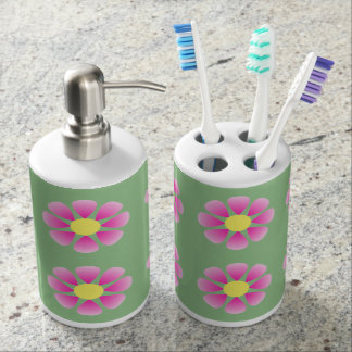Pink daisy pattern soap dispenser and toothbrush holder