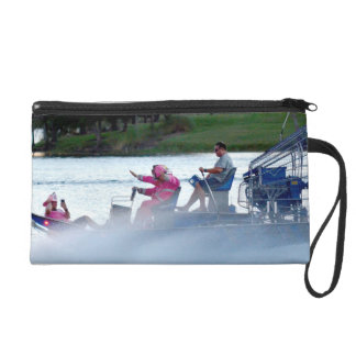 pink fire fighters on airboat in florida wristlet purse