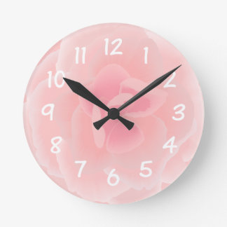 Pink flower done in watercolour effects round clock
