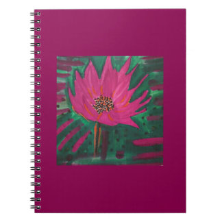 Pink flower on a maroon background. notebook