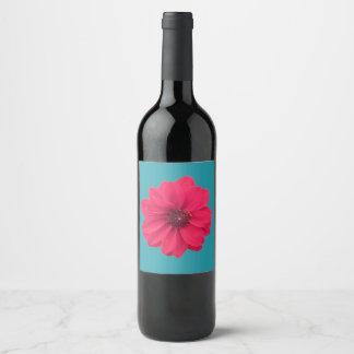 pink flower on blue wine label