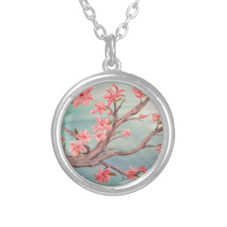Pink flowered tree branch with blue background silver plated necklace