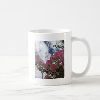 pink flowers against a blue sky coffee mug
