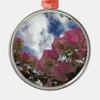 pink flowers against a blue sky metal ornament