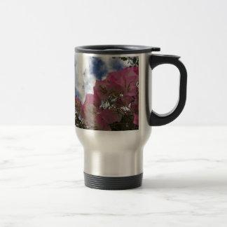 pink flowers against a blue sky travel mug
