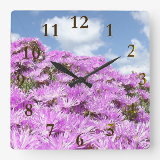 pink flowers blue and white sky square wall clock