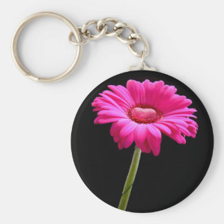 Pink gerbera with heart on black background key ring