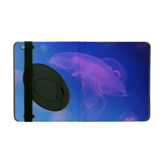 Pink jellyfishes in blue water iPad covers