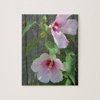 Pink on pink duo of hibiscus flowers jigsaw puzzle