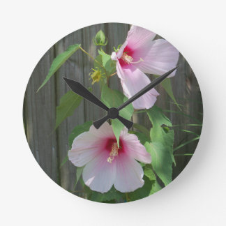 Pink on pink duo of hibiscus flowers round clock
