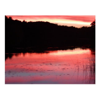 Pink, orange, and blue lake sunset postcard