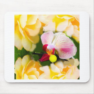 Pink orchid with tennis ball mouse pad