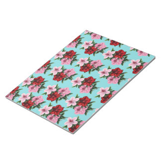 pink red flowers on teal light notepad