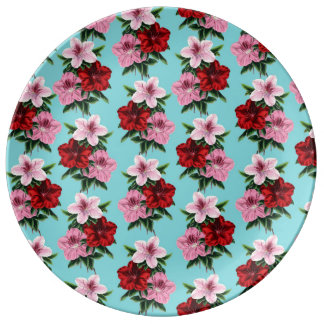 pink red flowers on teal light plate