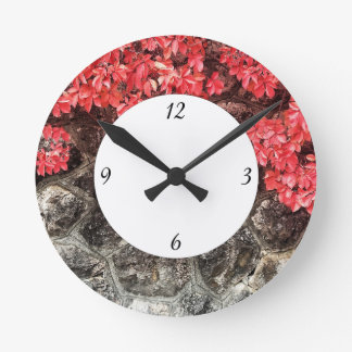 Pink red ivy leaves autumn stone wall with numbers round clock