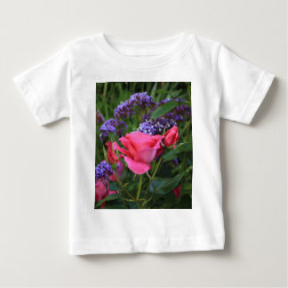 Pink rose and statice in garden baby T-Shirt