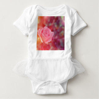 Pink rose covered by morning dew baby bodysuit