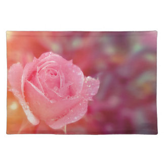 Pink rose covered by morning dew placemat