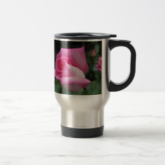Pink rose flowers with water droplets in spring travel mug