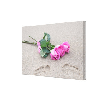 pink roses and footprints in sand canvas print