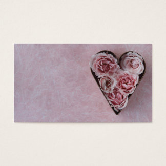 pink roses in a heart-shaped cookie cutter