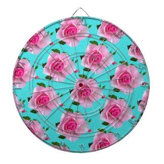 pink roses on teal dartboard