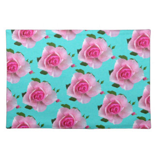 pink roses on teal placemat