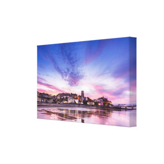 Pink sunset reflections over Cromer town at dusk Canvas Print