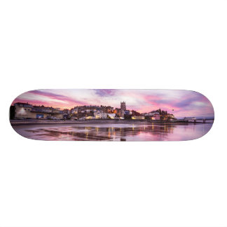 Pink sunset reflections over Cromer town at dusk Skate Board Decks