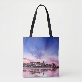 Pink sunset reflections over Cromer town at dusk Tote Bag
