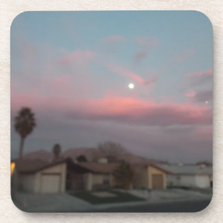 Pink sunset with the moon drink coaster
