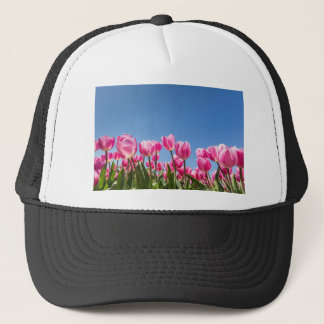 Pink tulips field with blue sky trucker hat