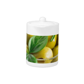 Pitted olives with green leaves and rosemary