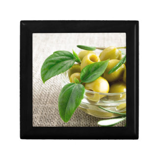 Pitted olives with green leaves and rosemary gift box