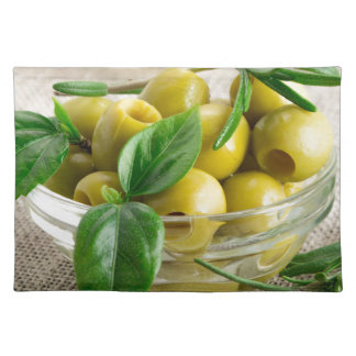 Pitted olives with green leaves and rosemary place mat