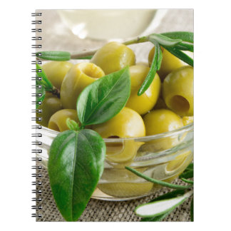 Pitted olives with green leaves and rosemary spiral notebook