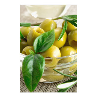 Pitted olives with green leaves and rosemary stationery