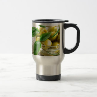 Pitted olives with green leaves and rosemary travel mug