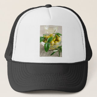 Pitted olives with green leaves and rosemary trucker hat
