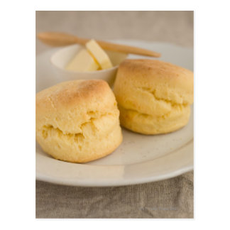 Plain scone with butter on plate postcard