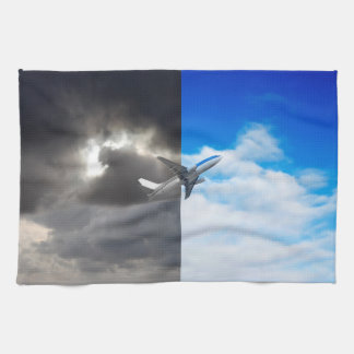 Plane flying out of stormy sky into blue sky tea towels